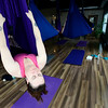 Jenna Weber works out during Aerial Yoga at Sangha Studios in Lafayette, Colorado February 28, 2013.  DAILY CAMERA/ MARK LEFFINGWELL