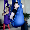 Rachel Benifield (right) and Michelle Shauf (left) begin stretching during Aerial Yoga at Sangha Studios in Lafayette, Colorado February 28, 2013.  DAILY CAMERA/ MARK LEFFINGWELL