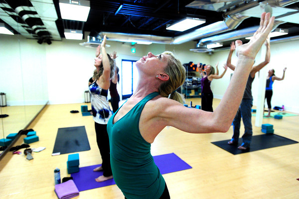 "Carolann Braxton works on a shoulder stretching pose during the 50+! Strength & Grace Yoga at the little Yoga Studio in Boulder on Tuesday October 9, 2012. For more photos and a video of the class go to  <a href=""http://www.dailycamera.com"">http://www.dailycamera.com</a><br /> Photos by Paul Aiken / The Boulder Camera"