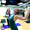 """Carolann Braxton works on a shoulder stretching pose during the 50+! Strength & Grace Yoga at the little Yoga Studio in Boulder on Tuesday October 9, 2012. For more photos and a video of the class go to  <a href=""""http://www.dailycamera.com"""">http://www.dailycamera.com</a><br /> Photos by Paul Aiken / The Boulder Camera"""