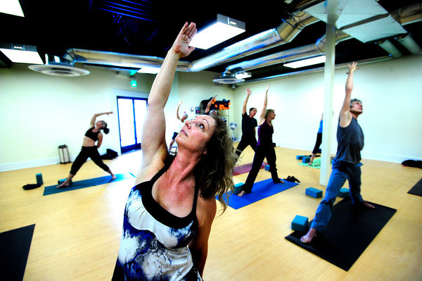 """Vanessa Stralow stretches to the ceiling during the 50+! Strength & Grace Yoga at the little Yoga Studio in Boulder on Tuesday October 9, 2012. For more photos and a video of the class go to  <a href=""""http://www.dailycamera.com"""">http://www.dailycamera.com</a><br /> Photos by Paul Aiken / The Boulder Camera"""