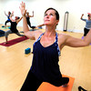 """Stacia Smith works in a shoulder stretch during the 50+! Strength & Grace Yoga at the little Yoga Studio in Boulder on Tuesday October 9, 2012. For more photos and a video of the class go to  <a href=""""http://www.dailycamera.com"""">http://www.dailycamera.com</a><br /> Photos by Paul Aiken / The Boulder Camera"""