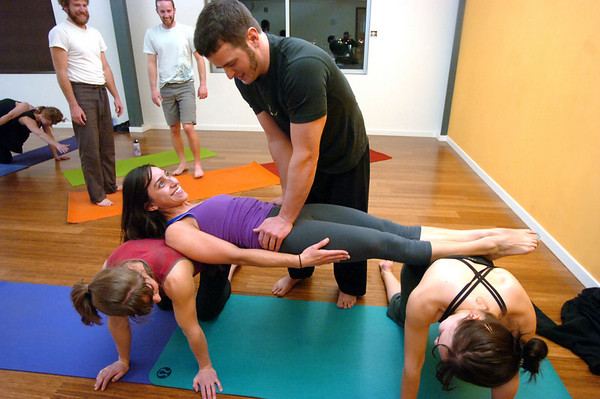 "Paul Robinson checks on Hayde Mitchell's ability to bridge betwen two other students during an Acro Yoga class at Movement Climbing + Fitness on Wednesday January 12, 2010. Acting as support on the left is Alex Kordick and at right Kristine Edwards.<br /> FOR MORE PHOTOS AND A VIDEO OF THE CLASS GO TO  <a href=""http://WWW.DAILYCAMERA.COM"">http://WWW.DAILYCAMERA.COM</a><br /> Photo by Paul Aiken / The Camera / January 12, 2010"