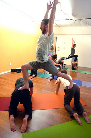 "Ryan Hamity strikes a pose on top of Paul Robinson left, and Kevin Suhr during an Acro Yoga class at Movement Climbing + Fitness on Wednesday January 12, 2010. <br /> FOR MORE PHOTOS AND A VIDEO OF THE CLASS GO TO  <a href=""http://WWW.DAILYCAMERA.COM"">http://WWW.DAILYCAMERA.COM</a><br /> Photo by Paul Aiken / The Camera / January 12, 2010"