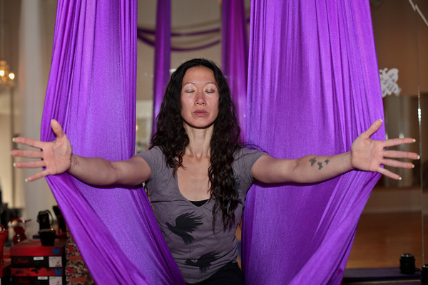 Sasha Viers leads her aerial yoga class in a Peek-A-Boo at Boulder Spirals on Saturday, May 19, 2012. (Morgan Varon/For the Camera)