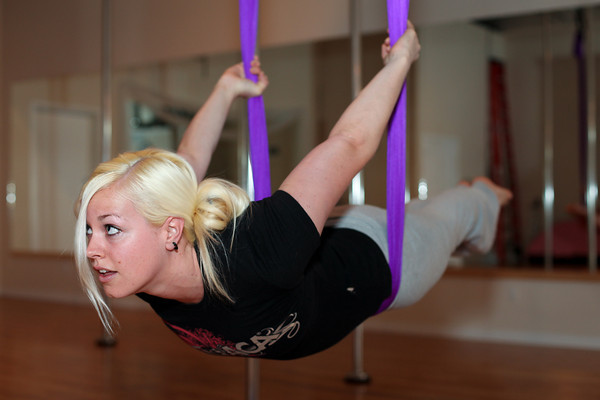 """""""At first it's hard to trust the hammock, but once you do, it's really fun,"""" says Chrissy Fairbanks, 26, while doing a Swan at Boulder Spirals on Saturday, May 19, 2012. (Morgan Varon/For the Camera)"""