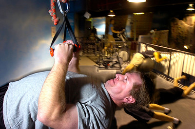 Mike Curtis does angled pull-ups during the Animal Strength workout at the Spot Gym in Boulder on Wednesday December 2, 2009. Watch a video of the workout and see more photos at www.dailycamera.com Photo by Paul Aiken / The Camera December 2, 2009.