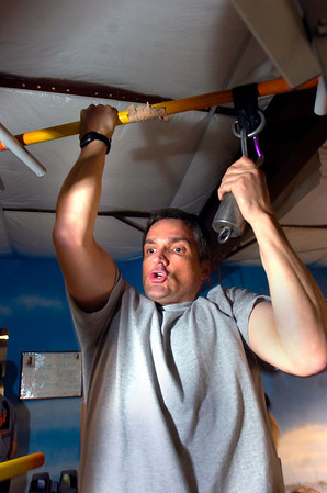 "Bill Nickerson does pulls ups during the Animal Strength workout at the Spot Gym in Boulder on Wednesday December 2, 2009. Watch a video of the workout and see more photos at  <a href=""http://www.dailycamera.com"">http://www.dailycamera.com</a><br /> Photo by Paul Aiken / The Camera December 2, 2009."
