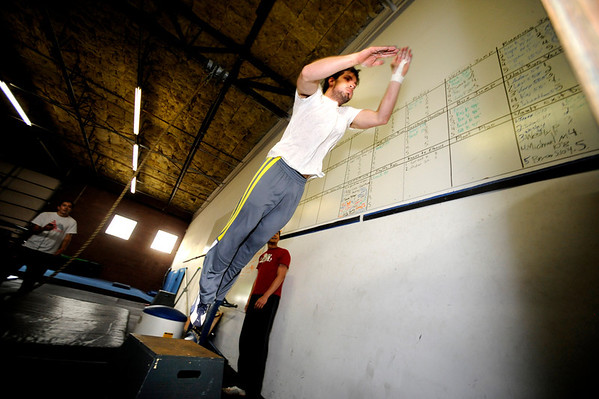 "Mike Merrill launches himself off a platform as part of a wall ""catching"" exercise during an intermediate level Parkour class at APEX Movement in Boulder on Monday June 13, 2011. Douglass is an instructor in training.<br /> Photo by Paul Aiken / The Camera<br /> For more photos and a video of the workout go to  <a href=""http://www.dailycamera.com"">http://www.dailycamera.com</a>"