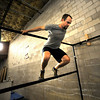 "Will Baird works his way through a set up bars as part of a timed obstacle course during an intermediate level Parkour class at APEX Movement in Boulder on Monday June 13, 2011.<br /> Photo by Paul Aiken / The Camera<br /> For more photos and a video of the workout go to  <a href=""http://www.dailycamera.com"">http://www.dailycamera.com</a>"