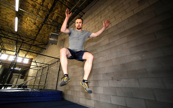 "Will Baird readys for a landing during a wall walking exercise during an intermediate level Parkour class at APEX Movement in Boulder on Monday June 13, 2011.<br /> Photo by Paul Aiken / The Camera<br /> For more photos and a video of the workout go to  <a href=""http://www.dailycamera.com"">http://www.dailycamera.com</a>"