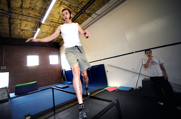 "Jon Stabile works across a balancing segment as part of a timed warmup obstacle course during an intermediate level Parkour class at APEX Movement in Boulder on Monday June 13, 2011.<br /> Photo by Paul Aiken / The Camera<br /> For more photos and a video of the workout go to  <a href=""http://www.dailycamera.com"">http://www.dailycamera.com</a>"