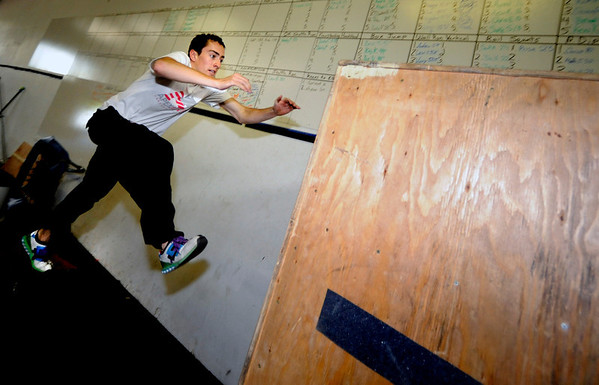 "Brandon Douglass launches himself off a platform to reach a ""wall"" during an intermediate level Parkour class at APEX Movement in Boulder on Monday June 13, 2011. Douglass is an instructor in training.<br /> Photo by Paul Aiken / The Camera<br /> For more photos and a video of the workout go to  <a href=""http://www.dailycamera.com"">http://www.dailycamera.com</a>"