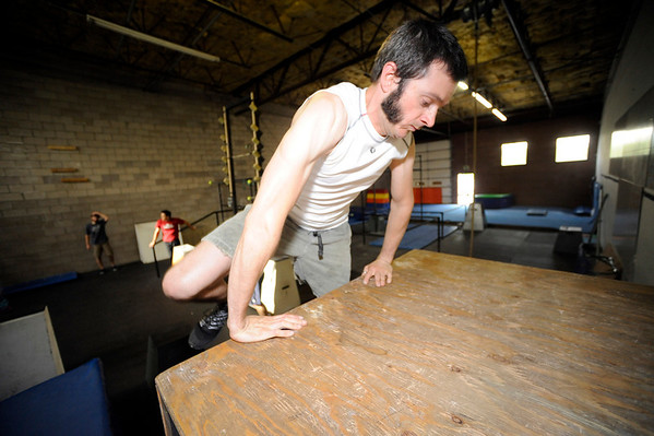 "Jon Stabile works on a wall climbing exercise during an intermediate level Parkour class at APEX Movement in Boulder on Monday June 13, 2011.<br /> Photo by Paul Aiken / The Camera<br /> For more photos and a video of the workout go to  <a href=""http://www.dailycamera.com"">http://www.dailycamera.com</a>"