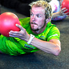 """Will Kelsay works a back exercise during the Awesome Abs class at Rallysport in Boulder. Photo by Paul Aiken / The Boulder Camera / December 8, 2011<br /> For more photos and a video of the class go to  <a href=""""http://www.dailycamera.com"""">http://www.dailycamera.com</a>"""