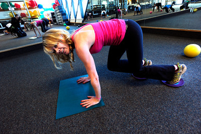 Instructor Cydney Brooks demonstrates an exercise during the Awesome Abs class at Rallysport in Boulder. Photo by Paul Aiken / The Boulder Camera / December 8, 2011 For more photos and a video of the class go to www.dailycamera.com