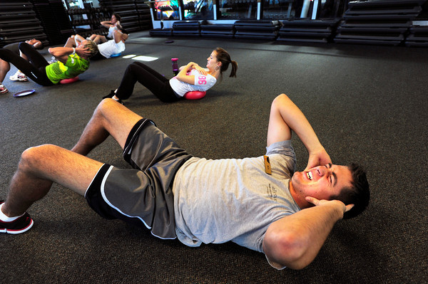 "Nick Johnson works through a sit up exercise during the Awesome Abs class at Rallysport in Boulder. Photo by Paul Aiken / The Boulder Camera / December 8, 2011<br /> For more photos and a video of the class go to  <a href=""http://www.dailycamera.com"">http://www.dailycamera.com</a>"