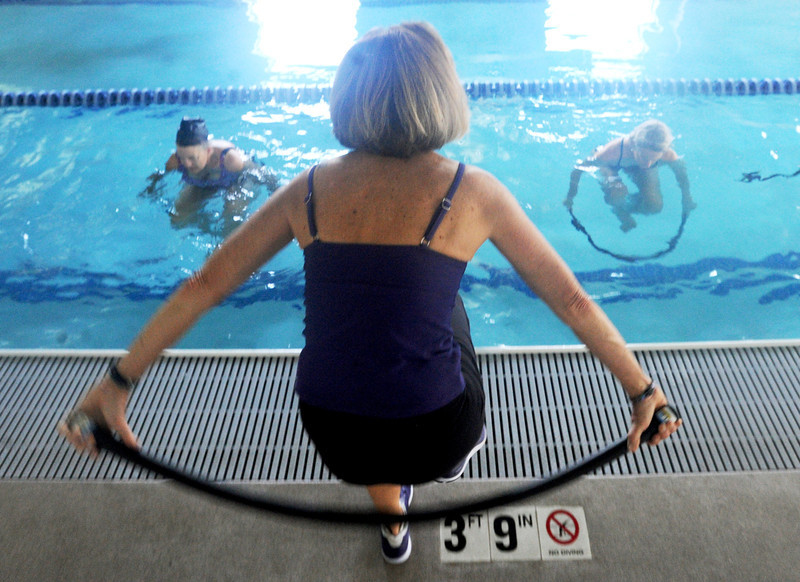 MaryAnn Briggs, center, teaches AquaFlex at the Colorado Athletic Club.<br /> Created by MaryAnn Briggs, a Boulder, Colorado-based water fitness instructor and personal trainer, the AquaFLEX Program is an effective low-impact workout for developing muscular strength and endurance, core conditioning, and dynamic flexibility, as well as being a fun and unique way to exercise in the water.<br /> Cliff Grassmick  / December 8, 2012