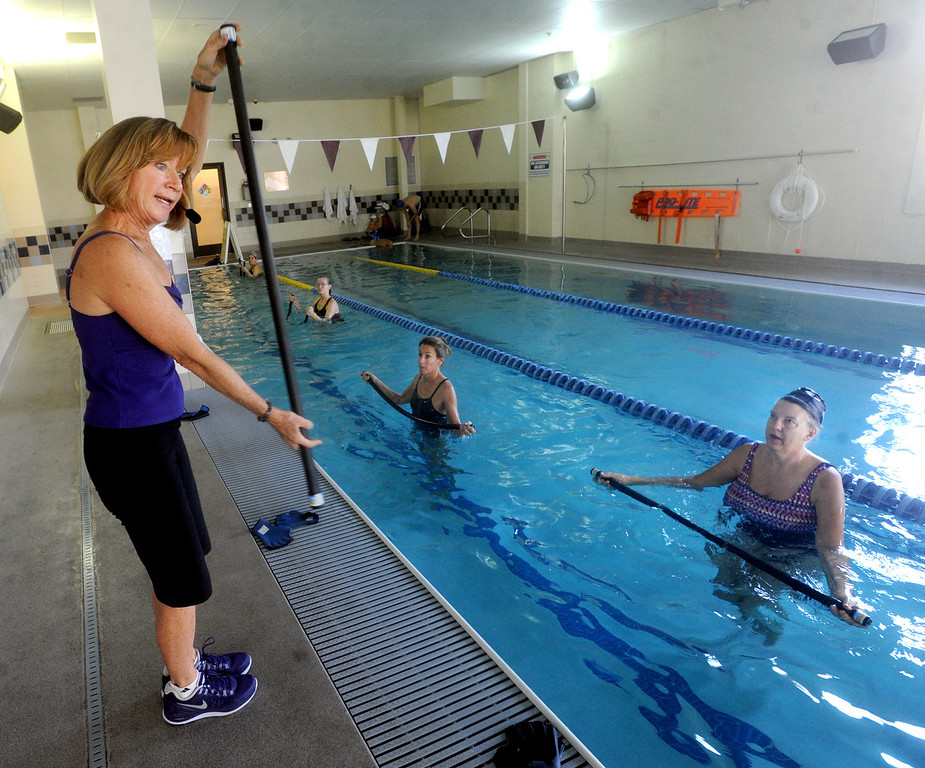 MaryAnn Briggs, left, teaches AquaFlex at the Colorado Athletic Club, Deb Coffin is the student on the right.<br /> Created by MaryAnn Briggs, a Boulder, Colorado-based water fitness instructor and personal trainer, the AquaFLEX Program is an effective low-impact workout for developing muscular strength and endurance, core conditioning, and dynamic flexibility, as well as being a fun and unique way to exercise in the water.<br /> Cliff Grassmick  / December 8, 2012