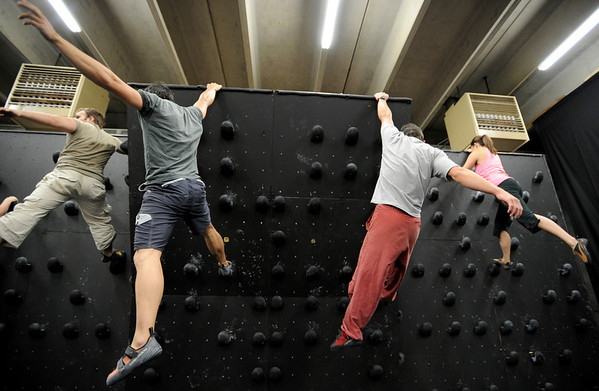 """Phil Kulikauskas, left, Brent Ng, Gordon Graham,  and Berkeley Almand, work on a routine on the climbing wall.<br /> For more photos and video of AscenDance, go to  <a href=""""http://www.dailycamera.com"""">http://www.dailycamera.com</a>.<br /> Cliff Grassmick / May 3, 2012"""