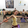 "Instructor Tabitha Farrar warms her class up during a beerasana yoga class at Asher Brewing Co. on Nautilus Court in Boulder. For more photos and video of the class go to  <a href=""http://www.dailycamera.com"">http://www.dailycamera.com</a><br /> Jeremy Papasso/ Camera"