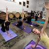 "Instructor Tabitha Farrar, right, leads her class during a beerasana yoga class at Asher Brewing Co. on Nautilus Court in Boulder. For more photos and video of the class go to  <a href=""http://www.dailycamera.com"">http://www.dailycamera.com</a><br /> Jeremy Papasso/ Camera"