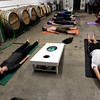 "Megan Martorano, of Longmont, left, and Matt Farrar, right, meditate during a beerasana yoga class at Asher Brewing Co. on Nautilus Court in Boulder. For more photos and video of the class go to  <a href=""http://www.dailycamera.com"">http://www.dailycamera.com</a><br /> Jeremy Papasso/ Camera"