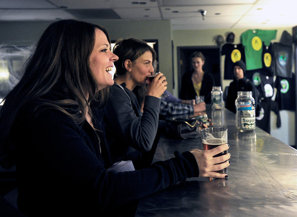 """Stacey Mulvey, of Boulder, left, and Diane Friedman, of Boulder, center, enjoy a beer after a beerasana yoga class at Asher Brewing Co. on Nautilus Court in Boulder. For more photos and video of the class go to  <a href=""""http://www.dailycamera.com"""">http://www.dailycamera.com</a><br /> Jeremy Papasso/ Camera"""