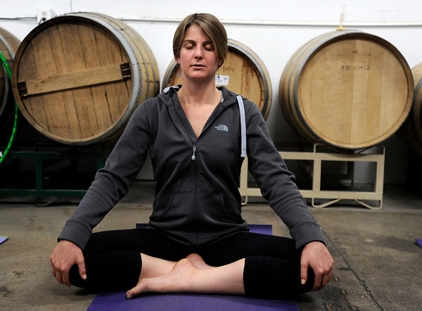 "Diane Friedman, of Boulder, meditates during a beerasana yoga class at Asher Brewing Co. on Nautilus Court in Boulder. For more photos and video of the class go to  <a href=""http://www.dailycamera.com"">http://www.dailycamera.com</a><br /> Jeremy Papasso/ Camera"