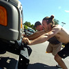 "Instructor Heath Croll, at left helps Matthew Seagal push a jeep up a hill in the BLAST Cardio class at Movement Climbing and Fitness on August 27, 2010.<br /> FOR A VIDEO OF THE CLASS GO TO  <a href=""http://WWW.DAILYCAMERA.COM"">http://WWW.DAILYCAMERA.COM</a><br /> Photo by Paul Aiken /  August 27, 2010."