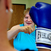 From left, Stacey Donelson, of Longmont, boxes with her partner Angel Faull, of Longmont, at the Boxing workout for moms class in the Family Garden in Longmont, Colorado July 5, 2012. Rachel Woolf/ For the Daily Camera