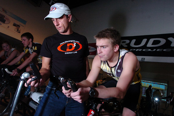 "Mike Ricci, ower of the D3 Energy Lab checks Drew Auer on bike computer and information monitor during a compu-training session D3 Energy Lab in Boulder on Tuesday December 7, 2010.  FOR A VIDEO OF THE WORKOUT GO TO  <a href=""http://WWW.DAILYCAMERA.COM"">http://WWW.DAILYCAMERA.COM</a><br /> Photo by Paul Aiken / The Camera /"
