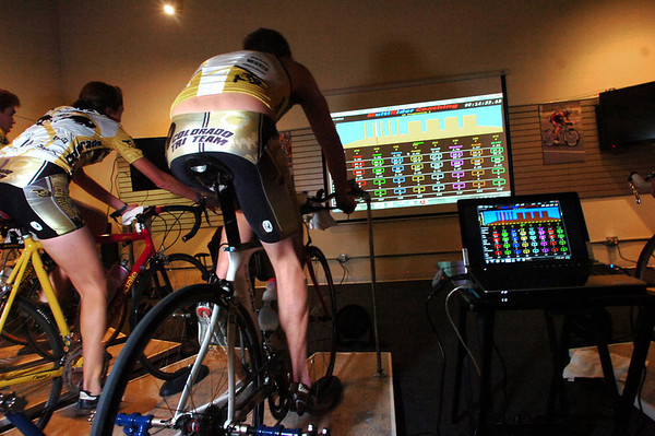 "Sabina Bastias, left, and Drew Auer with monitors showing their on bike performance during a compu-training session D3 Energy Lab in Boulder on Tuesday December 7, 2010.  FOR A VIDEO OF THE WORKOUT GO TO  <a href=""http://WWW.DAILYCAMERA.COM"">http://WWW.DAILYCAMERA.COM</a><br /> Photo by Paul Aiken / The Camera /"