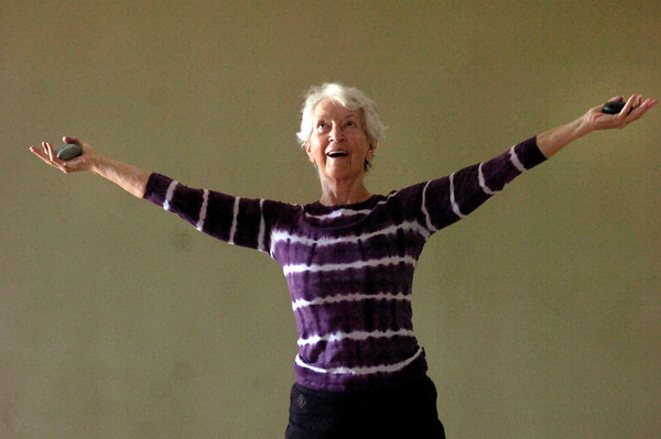 """Jo Ann Zender holds stones and lifts two stones upward in a strenghtening exercise during the Core Stone Yoga at the YMCA of Boulder Valley Arapahoe Branch on Thursday April 21, 2011.<br /> For more photos and a video of the class go to  <a href=""""http://www.dailycamera.com"""">http://www.dailycamera.com</a>.<br /> Photo by Paul Aiken / The Camera / <br /> Workout of the Week"""