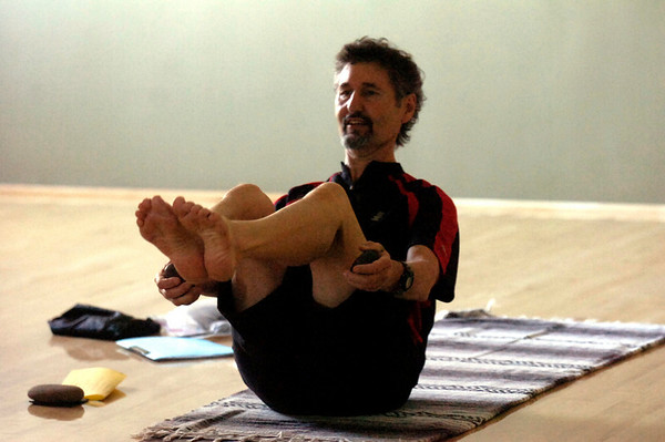 """Instructor Makaan Burt uses stones in a strenth and balancin pose during the Core Stone Yoga at the YMCA of Boulder Valley Arapahoe Branch on Thursday April 21, 2011.<br /> For more photos and a video of the class go to  <a href=""""http://www.dailycamera.com"""">http://www.dailycamera.com</a>.<br /> Photo by Paul Aiken / The Camera / <br /> Workout of the Week"""