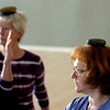 "From left to right Jo Ann Zender and Susannah Tenney use stones on their heads during a balance and stretching sequence during the Core Stone Yoga at the YMCA of Boulder Valley Arapahoe Branch on Thursday April 21, 2011.<br /> For more photos and a video of the class go to  <a href=""http://www.dailycamera.com"">http://www.dailycamera.com</a>.<br /> Photo by Paul Aiken / The Camera / <br /> Workout of the Week"
