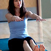 "Natha Perkins works with a stone during a balance sequence during the Core Stone Yoga at the YMCA of Boulder Valley Arapahoe Branch on Thursday April 21, 2011.<br /> For more photos and a video of the class go to  <a href=""http://www.dailycamera.com"">http://www.dailycamera.com</a>.<br /> Photo by Paul Aiken / The Camera / <br /> Workout of the Week"