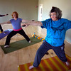 "From left to right Jo Ann Zender, Susannah Tenney and Caroline Ossoria settle into Warrior Two pose while holding stones during the Core Stone Yoga at the YMCA of Boulder Valley Arapahoe Branch on Thursday April 21, 2011.<br /> For more photos and a video of the class go to  <a href=""http://www.dailycamera.com"">http://www.dailycamera.com</a>.<br /> Photo by Paul Aiken / The Camera / <br /> Workout of the Week"