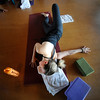 Kendra Horn Trevino works a shoulder stretching pose during the Corerestore class at Corepower Yoga in Boulder on Thursday July 28, 2011.<br /> For more photos and a video of the class <br /> Photo by Paul Aiken