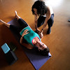 Instructor Laura Kupperman helps Hannah Schuster work into a shoulder stretch during the Corerestore class at Corepower Yoga in Boulder on Thursday July 28, 2011.<br /> For more photos and a video of the class <br /> Photo by Paul Aiken