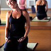 Jennifer Rizzo warms up with a neck stretch during the Corerestore class at Corepower Yoga in Boulder on Thursday July 28, 2011.<br /> For more photos and a video of the class <br /> Photo by Paul Aiken