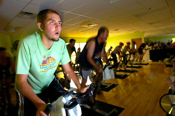 """Davis Gunderson works into a sweat during the Cycle/Yoga class at the Louisville Recreation Center on Monday October 18, 2010. FOR MORE PHOTOS GO TO  <a href=""""http://WWW.DAILYCAMERA.COM"""">http://WWW.DAILYCAMERA.COM</a><br /> cycle<br /> yoga"""