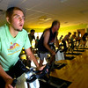 "Davis Gunderson works into a sweat during the Cycle/Yoga class at the Louisville Recreation Center on Monday October 18, 2010. FOR MORE PHOTOS GO TO  <a href=""http://WWW.DAILYCAMERA.COM"">http://WWW.DAILYCAMERA.COM</a><br /> cycle<br /> yoga"