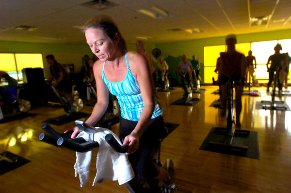 "Mari Minari works on a stationary bike during the Cycle/Yoga class at the Louisville Recreation Center on Monday October 18, 2010. FOR MORE PHOTOS GO TO  <a href=""http://WWW.DAILYCAMERA.COM"">http://WWW.DAILYCAMERA.COM</a><br /> cycle<br /> yoga"