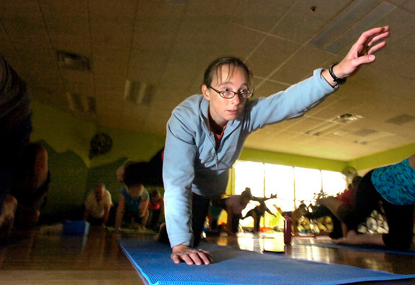 "Lessley Hanley moves into a yoga pose during the Cycle/Yoga class at the Louisville Recreation Center on Monday October 18, 2010. FOR MORE PHOTOS GO TO  <a href=""http://WWW.DAILYCAMERA.COM"">http://WWW.DAILYCAMERA.COM</a><br /> cycle<br /> yoga"