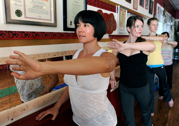 "Vivienne Palmer, of Boulder, left, Instructor Stacey Mulvey and Tabitha Farrar work out during a Callanetics workout class on Wednesday, Nov. 7, at A Place to Be Studio in Boulder. For a video of the class go to  <a href=""http://www.dailycamera.com"">http://www.dailycamera.com</a><br /> Jeremy Papasso/ Camera"