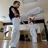 "Marcel Reyes, 7, appears to have good form on his kicks.<br /> Luis Carlos A. Silva, also known as Mestre Lucas Corvo ( Lucas the Crow), teaches Capoeira classes.<br /> For more photos and a video of Capoeira, go to  <a href=""http://www.dailycamera.com"">http://www.dailycamera.com</a><br /> Cliff Grassmick / June 16, 2011"
