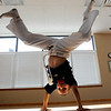 "Marcel Reyes, 7, appears to have this move down.<br /> Luis Carlos A. Silva, also known as Mestre Lucas Corvo ( Lucas the Crow), teaches Capoeira classes.<br /> For more photos and a video of Capoeira, go to  <a href=""http://www.dailycamera.com"">http://www.dailycamera.com</a><br /> Cliff Grassmick / June 16, 2011"