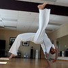 "Luis Carlos A. Silva, also known as Mestre Lucas Corvo ( Lucas the Crow), goes through a Capoeira routine during class.<br /> For more photos and a video of Capoeira, go to  <a href=""http://www.dailycamera.com"">http://www.dailycamera.com</a><br /> Cliff Grassmick / June 16, 2011"