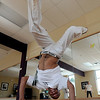 """Luis Carlos A. Silva, also known as Mestre Lucas Corvo ( Lucas the Crow), goes through a Capoeira routine during class.<br /> For more photos and a video of Capoeira, go to  <a href=""""http://www.dailycamera.com"""">http://www.dailycamera.com</a><br /> Cliff Grassmick / June 16, 2011"""